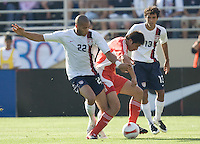 Oguchi Onyewu fights for the ball as Jonathan Bornstein looks on. The USA defeated China, 4-1, in an international friendly at Spartan Stadium, San Jose, CA on June 2, 2007.