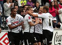 Pictured: (L-R) Ashley Williams, Mark Gower, Garry Monk and Lee Trundle of Swansea City in action <br />