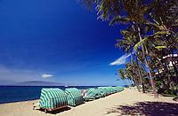 Sun cabanas on Kaanapali Beach facing the island of Lanai from Maui, Hawaii.