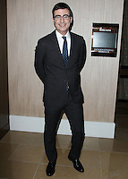 BEVERLY HILLS, CA, USA - OCTOBER 14: John Oliver arrives at the 20th Annual Fulfillment Fund Stars Benefit Gala held at The Beverly Hilton Hotel on October 14, 2014 in Beverly Hills, California, United States. (Photo by Celebrity Monitor)