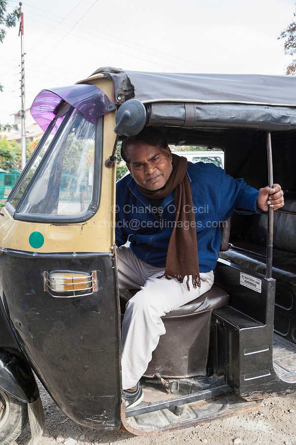 India, Dehradun.   Taxi Driver of a Three-wheeled Vehicle Common in India.