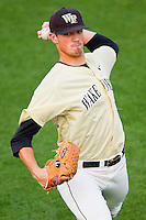 Wake Forest Demon Deacons starting pitcher Brian Holmes #45 warms up in the outfield prior to the game against the Miami Hurricanes at NewBridge Bank Park on May 25, 2012 in Winston-Salem, North Carolina.  The Hurricanes defeated the Demon Deacons 6-3.  (Brian Westerholt/Four Seam Images)