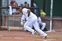 Elizabethton Twins first baseman Amaurys Minier (39) swings at a pitch during a game against the Johnson City Cardinals on July 30, 2015 in Elizabethton, Tennessee. The Twins defeated the Cardinals 13-4. (Tony Farlow/Four Seam Images)