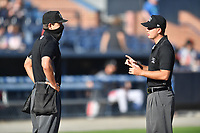 Umpires Adam Clark and Clay Williams before game on June 15, 2021 between the Aberdeen IronBirds and the Asheville Tourists at McCormick Field in Asheville, NC. (Tony Farlow/Four Seam Images)