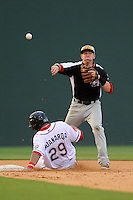 Second baseman Ryan Rua (2) of the Hickory Crawdads makes the throw as a sliding Boss Moanaroa (29) of the Greenville Drive breaks up the double play in a game on Friday, June 7, 2013, at Fluor Field at the West End in Greenville, South Carolina. Greenville won the resumption of this May 22 suspended game, 17-8. (Tom Priddy/Four Seam Images)
