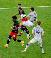 WASHINGTON, DC - NOVEMBER 8: Ola Kamara #9 of D.C. United goes up for a header with Rudy Camacho #4 of the Montreal Impact during a game between Montreal Impact and D.C. United at Audi Field on November 8, 2020 in Washington, DC.