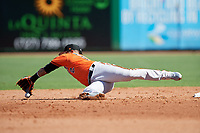 Baltimore Orioles second baseman Jonathan Villar (2) makes a backhanded stop on an errant throw during a Grapefruit League Spring Training game against the Philadelphia Phillies on February 28, 2019 at Spectrum Field in Clearwater, Florida.  Orioles tied the Phillies 5-5.  (Mike Janes/Four Seam Images)