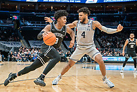 WASHINGTON, DC - FEBRUARY 19: David Duke #3 of Providence dribbles past Jagan Mosely #4 of Georgetown during a game between Providence and Georgetown at Capital One Arena on February 19, 2020 in Washington, DC.