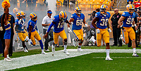 Members of the Pitt football team along with head coach Pat Narudzzi (white shirt) take the field to play the Syracuse Orange. The Pitt Panthers defeated the Syracuse Orange 44-37 in overtime at Heinz Field in Pittsburgh, Pennsylvania on October 6, 2018.