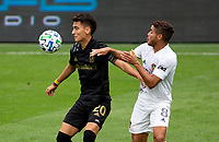 LOS ANGELES, CA - OCTOBER 25: Eduard Atuesta #20 of LAFC and Jonathan dos Santos #8 of the Los Angeles Galaxy battle during a game between Los Angeles Galaxy and Los Angeles FC at Banc of California Stadium on October 25, 2020 in Los Angeles, California.