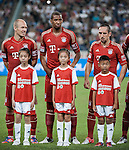 Arjen Robben, Jerome Boateng and Franck Ribery of Bayern Munich line-up before a friendly match against VfL Wolfsburg as part of the Audi Football Summit 2012 on July 26, 2012 at the Guangdong Olympic Sports Center in Guangzhou, China. Photo by Victor Fraile / The Power of Sport Images