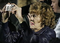 State College, PA - 11/06/2010:  Joe Paterno's wife, Sue, takes a photo from the sidelines in the closing seconds of the game.  Despite trailing 21-0 in the first quarter, Penn State defeated Northwestern by a score of 35-21 at Beaver Stadium to give head coach Joe Paterno his 400th career victory...Photo:  Joe Rokita / JoeRokita.com..Photo ©2010 Joe Rokita Photography