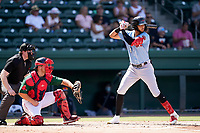 Center fielder Pedro Gonzalez (4) of the Hickory Crawdads in a game against the Greenville Drive on Sunday, August 29, 2021, at Fluor Field at the West End in Greenville, South Carolina. The catcher is Stephen Scott (23) and the umpire is Mitch Leikam. (Tom Priddy/Four Seam Images)