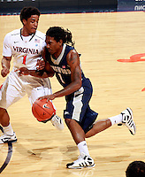 CHARLOTTESVILLE, VA- December 3: Jeremiah Bowman #1 of the Longwood Lancers drives past Jontel Evans #1 of the Virginia Cavaliers during the game on December 27, 2011 at the John Paul Jones Arena in Charlottesville, Virginia. Virginia defeated Longwood 86-53. (Photo by Andrew Shurtleff/Getty Images) *** Local Caption *** Jontel Evans;Jeremiah Bowman