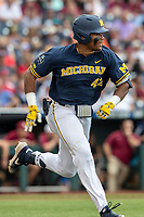 Michigan Wolverines designated hitter Jordan Nwogu (42) runs to first base during Game 6 of the NCAA College World Series against the Florida State Seminoles on June 17, 2019 at TD Ameritrade Park in Omaha, Nebraska. Michigan defeated Florida State 2-0. (Andrew Woolley/Four Seam Images)