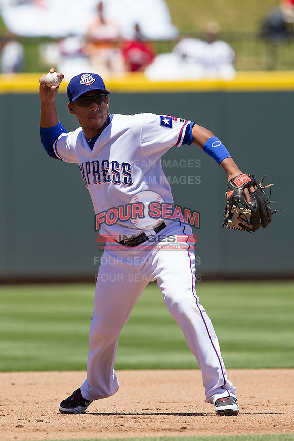 Round Rock third baseman Yangervis Solarte (26) makes a throw to first base against the Nashville Sounds in the Pacific Coast League baseball game on May 5, 2013 at the Dell Diamond in Round Rock, Texas. Round Rock defeated Nashville 5-1. (Andrew Woolley/Four Seam Images).