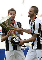 Calcio, Serie A: Juventus vs Crotone. Torino, Juventus Stadium, 21 maggio 2017.<br /> Juventus' Claudio Marchisio, left, and Leonardo Bonucci hold the trophy during the celebrations for the victory of the sixth consecutive Scudetto at the end of the Italian Serie A football match between Juventus and Crotone at Turin's Juventus Stadium, 21 May 2017. Juventus defeated Crotone 3-0.<br /> UPDATE IMAGES PRESS/Isabella Bonotto