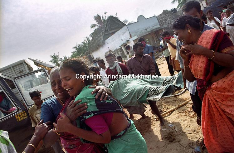 Two griief-striken women in  Velankanni beach.Nagapattinam.India.