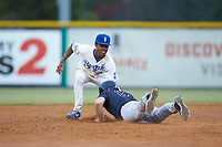 Burlington Royals shortstop Maikel Garcia (2) applies a tag as Ryder Green (21) of the Pulaski Yankees dives head first into second base at Burlington Athletic Stadium on August 25, 2019 in Burlington, North Carolina. The Yankees defeated the Royals 3-0. (Brian Westerholt/Four Seam Images)