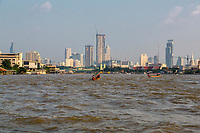 Bangkok, Thailand.  City Skyline beyond the Chao Phraya River.