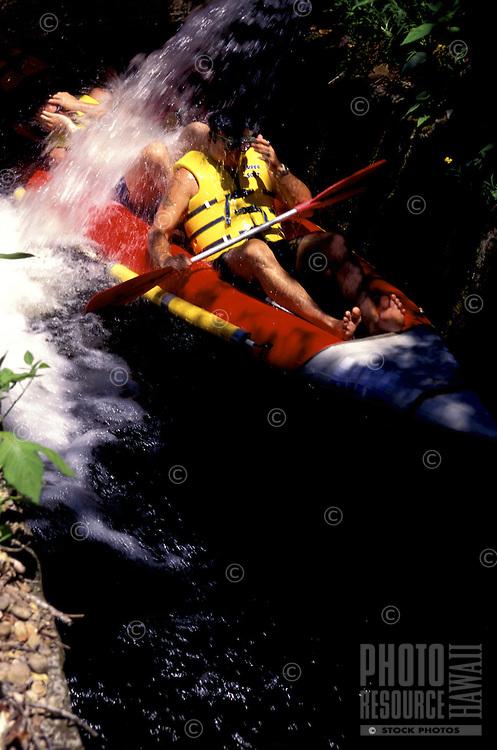 Tourists enjoying the Kohala Mountain Kayak Cruise on the Big Island of Hawaii, a 22.5 mile ride through the former irrigation system of the inaccessible and historic Kohala sugar plantation.