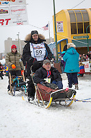 Jim Lanier and team leave the ceremonial start line at 4th Avenue and D street in downtown Anchorage during the 2013 Iditarod race. Photo by Jim R. Kohl/IditarodPhotos.com