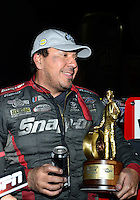 Nov. 11, 2012; Pomona, CA, USA: NHRA funny car driver Cruz Pedregon celebrates after winning the Auto Club Finals at at Auto Club Raceway at Pomona. Mandatory Credit: Mark J. Rebilas-