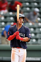 Third baseman Tanner Nishioka (30) of the Greenville Drive in Game 1 of a doubleheader against the Hickory Crawdads on Wednesday, July 25, 2018, at Fluor Field at the West End in Greenville, South Carolina. Greenville won, 4-1. (Tom Priddy/Four Seam Images)