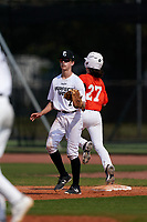 First baseman Ethan Monrad (7) waits for a throw as Chase Crawford (27) runs through the bag during the Perfect Game National Underclass East Showcase on January 23, 2021 at Baseball City in St. Petersburg, Florida.  (Mike Janes/Four Seam Images)