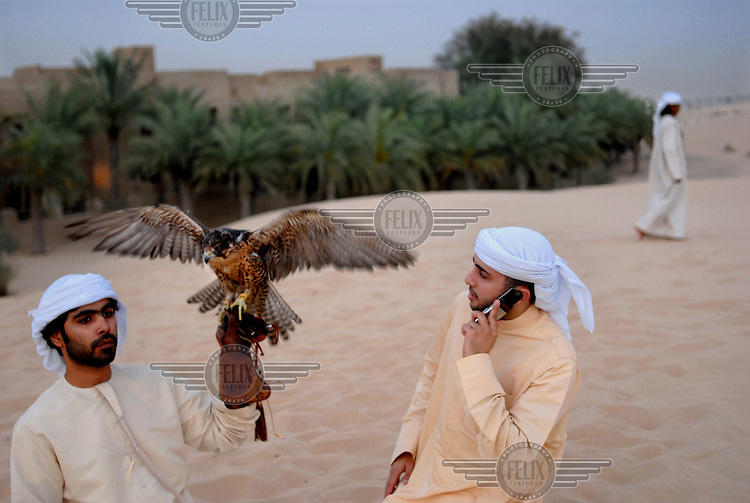 Young men train their falcon, one of the symbols of Dubai, at the Bab Al Shams resort outside the city.