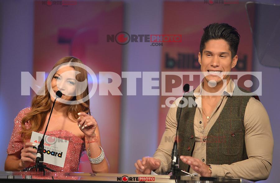 MIAMI, FL - FEBRUARY 05: Adriana Fonseca and Chino at the Telemundo and Premios Billboard 2013 Press Conference at Gibson Miami Showroom on February 5, 2013 in Miami, Florida. © MPI10/MediaPunch Inc /NortePhoto