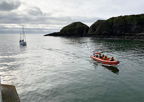The crew of the inshore lifeboat Jamie Hunter escort a sailing vessel with engine trouble into Stonehaven Harbour | Credit: RNLI