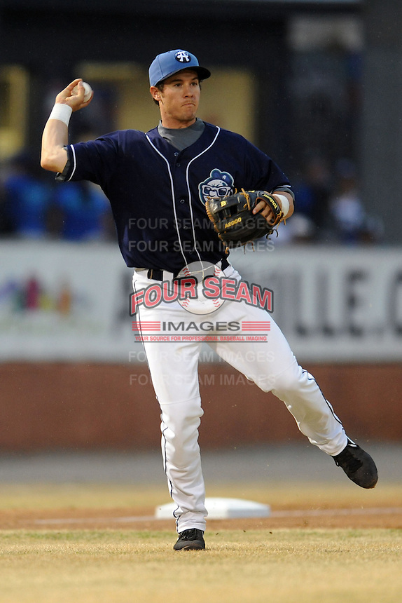 Asheville Tourists third baseman Jason Stolz #11 throws to first during a game suspended by rain against the West Virginia Power at McCormick Field on April 11, 2013 in Asheville, North Carolina. The Power eventually won 11-4. (Tony Farlow/Four Seam Images).