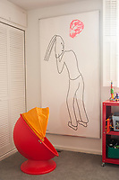 This child's bedroom features a Ikea swivel chair beneath ''I Dreamed I Found a Red Ruby,'' a print by Jonathan Borofsky.