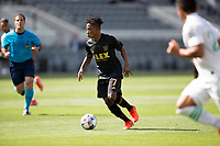 LOS ANGELES, CA - APRIL 17: Latif Blessing #7 of LAFC moves with the ball during a game between Austin FC and Los Angeles FC at Banc of California Stadium on April 17, 2021 in Los Angeles, California.