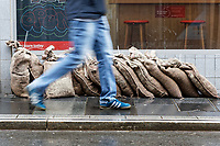 Pictured: A man walks in front of sandbags by a shop that was affected by the floods in Taff Street, Pontypridd. Wednesday 04 March 2020<br /> Re: Revisiting the flood affected areas in Pontypridd, Wales, UK.