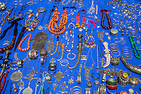 Essaouira, Morocco.  Jewelry, Necklaces, Bracelets, Hand of Fatima, Displayed on the Sidewalk for sale in the medina.