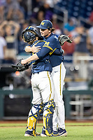 Michigan Wolverines pitcher Tommy Henry (47) celebrates with catcher Joe Donovan (0) following Game 6 of the NCAA College World Series against the Florida State Seminoles on June 17, 2019 at TD Ameritrade Park in Omaha, Nebraska. Michigan defeated Florida State 2-0. (Andrew Woolley/Four Seam Images)