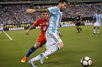 Action photo during the match Argentina vs Chile, Corresponding to Great Final of the America Centenary Cup 2016 at Metlife Stadium, East Rutherford, New Jersey.<br /> <br /> <br /> Foto de accion durante el partido Argentina vs Chile, correspondiente a la Gran Final de la Copa America Centenario 2016 en el  Metlife Stadium, East Rutherford, Nueva Jersey, en la foto: (i-d) Gary Medel de Chile y Lionel Messi de Argentina  <br /> <br /> <br /> 26/06/2016/MEXSPORT/David Leah.