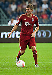 GUANGZHOU, GUANGDONG - JULY 26:  Toni Kroos of Bayern Munich in action during a friendly match against VfL Wolfsburg as part of the Audi Football Summit 2012 on July 26, 2012 at the Guangdong Olympic Sports Center in Guangzhou, China. Photo by Victor Fraile / The Power of Sport Images