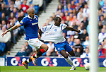 Rangers v St Johnstone....28.08.10  .Cleveland Taylor is pulled back by Madjid Bouugherra.Picture by Graeme Hart..Copyright Perthshire Picture Agency.Tel: 01738 623350  Mobile: 07990 594431
