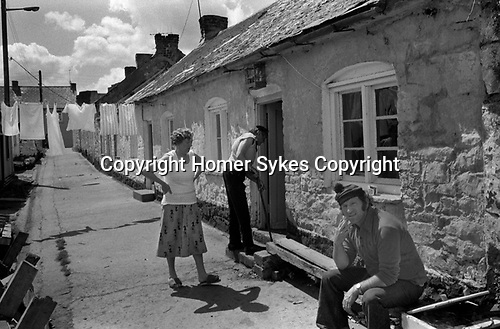 Limerick, in County Limerick, Southern Ireland Eire 1979. Fisherman out side his fisherman's cottage. Fist on the River Shannon.