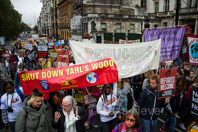 """London, 17/09/2016. Today, an estimated 20,000 people gathered in Park Lane to attend the """"Refugees Welcome Here March"""" organised by """"Solidarity with Refugees"""". The peacefull demonstration ended with a rally in Parliament Square. From the organiser press release: << Last September, the image of 3 year old Aylan Kurdi's body on a Turkish beach horrified the world. 100,000 of us marched in London in response to tell our government that we want to welcome refugees in the UK, and to stop the drowning. Since then, thousands more terrified and desperate refugees, including hundreds of children, have lost their lives trying to reach safety in Europe. This September, world leaders will meet to discuss the refugee crisis at two crucial summits. This is the biggest opportunity of 2016 to show our government and the world that Britain is ready to welcome more refugees. Many British people have responded to the tragedy they see unfolding on their doorstep with extraordinary displays of humanity and generosity. They've been moved to act after seeing many thousands trapped in camps in Greece without running water or baby formula; thousands of people drowning in the Mediterranean as refugees seek increasingly dangerous routes to safety since the closing of borders and the sea route from Turkey; the continuing misery of the camp in Calais; the injustices and inefficiencies of Britain's own asylum system. 80% of Britons want our government to do more to help. Polls now show that 1 in 4 of us would welcome a refugee in our own home. We want to tell the government that we are waiting to help. The UK should be leading the way and working with other states to give refugees safe, legal routes to asylum, ending the trade in people smuggling […]>>.<br /> <br /> For more information please click here: https://www.facebook.com/events/1563121147327378/ & http://swruk.org/"""