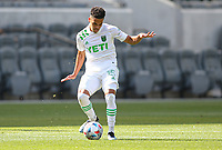 LOS ANGELES, CA - APRIL 17: Daniel Pereira #15 of Austin FC passes off the ball during a game between Austin FC and Los Angeles FC at Banc of California Stadium on April 17, 2021 in Los Angeles, California.