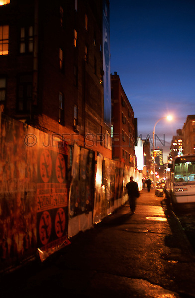 Two People Walking on Lafayette Street at Dusk, East Village, New York City, New York State, USA