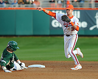 Shortstop Tyler Krieger (3) of the Clemson Tigers makes the output at second base against Charley Gould (23) of the William & Mary Tribe on Opening Day, Friday, February 15, 2013, at Doug Kingsmore Stadium in Clemson, South Carolina. Clemson won, 2-0. (Tom Priddy/Four Seam Images)
