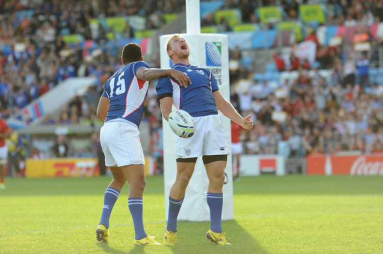 Johan Tromp of Namibia shows how much it means to  score his team's opening try  during Match 20 of the Rugby World Cup 2015 between Tonga and Namibia - 29/09/2015 - Sandy Park, Exeter<br /> Mandatory Credit: Rob Munro/Stewart Communications
