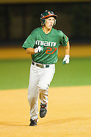 Brad Fieger #27 of the Miami Hurricanes hustles towards third base against the Wake Forest Demon Deacons at Gene Hooks Field on March 18, 2011 in Winston-Salem, North Carolina.  Photo by Brian Westerholt / Four Seam Images