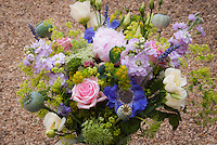 Cut flower arrangement with roses Rosa, Alchemilla, phlox, Poppies Papaver, Ammi, etc