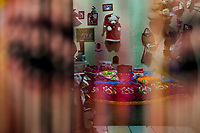 An adorned room where sexual services are offered to clients is seen through the bead curtain in a street sex club in San Salvador, El Salvador, 10 November 2016. Although prostitution is not legal in El Salvador, dozens of street sex workers, wearing provocative miniskirts, hang out in the dirty streets close to the capital's historic center. Sex workers of all ages are seen on the streets but a significant part of them are single mothers abandoned by their male partners. Due to the absence of state social programs, they often seek solutions to their economic problems in sex work. The environment of street sex business is strongly competitive and dangerous, closely tied to the criminal networks (street gangs) that demand extortion payments. Therefore, sex workers employ any tool at their disposal to struggle hard, either with their fellow workers, with violent clients or with gang members who operate in the harsh world of street prostitution.